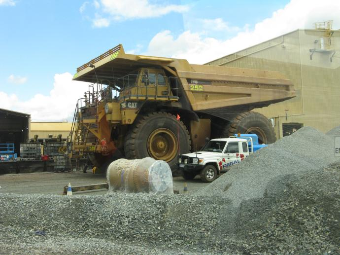 One of the huge dump trucks that collect the dirt from the pit